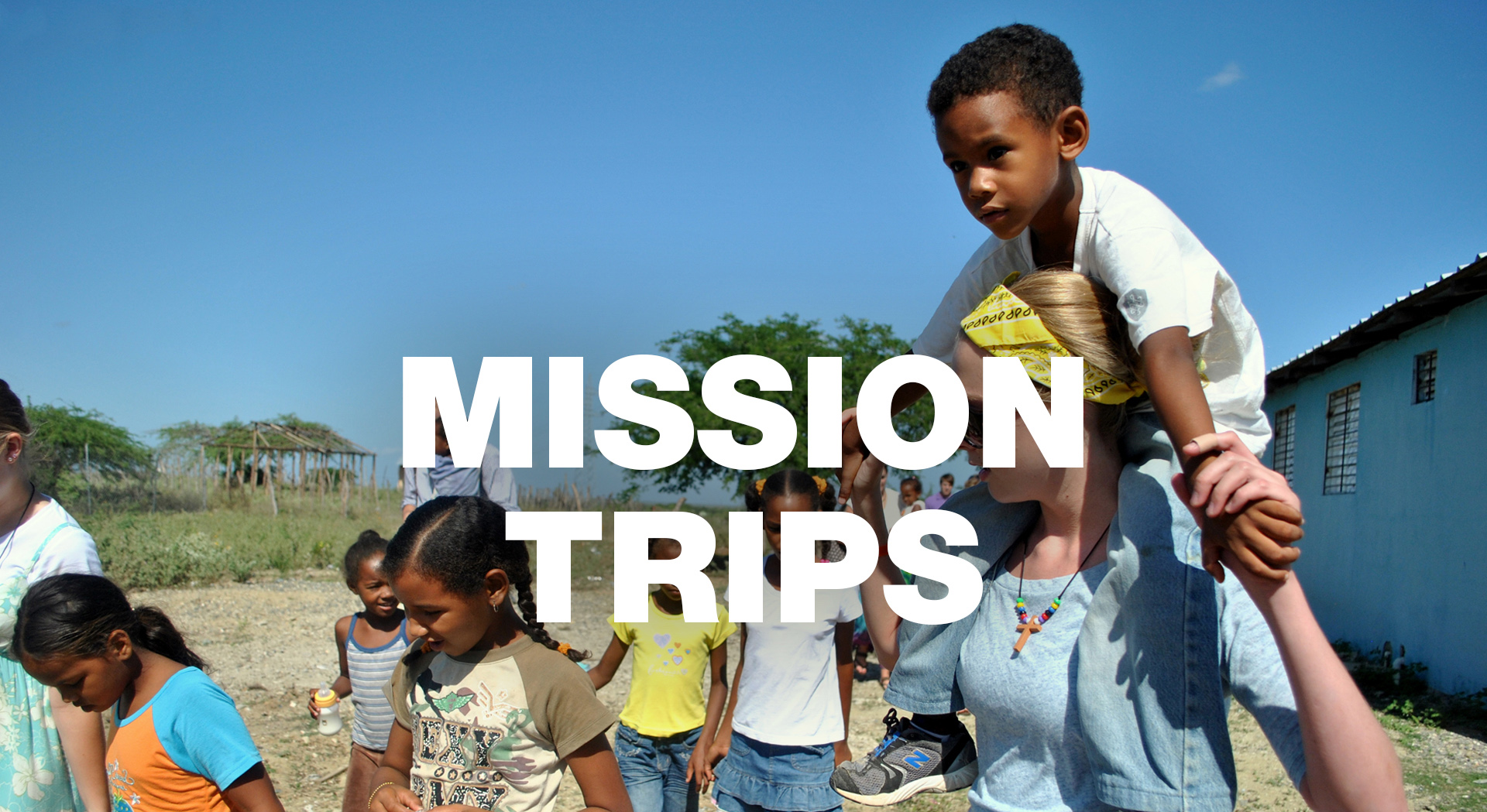 Child being carried during church Mission trip